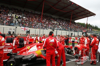 Felipe Massa, Ferrari on the grid as Greenpeace protest against race title sponsors Shell on the main grandstand