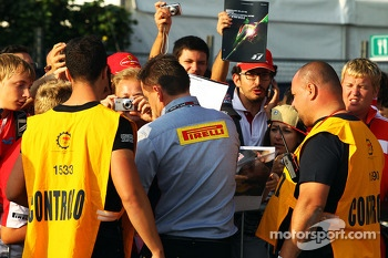 Paul Hembery, Pirelli Motorsport Director signs autographs for the fans