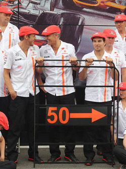 (L to R): Jenson Button, McLaren; Martin Whitmarsh, McLaren Chief Executive Officer; and Sergio Perez, McLaren celebrate 50 years of McLaren as a constructor