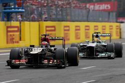 Kimi Raikkonen, Lotus F1 Team and Lewis Hamilton, Mercedes Grand Prix