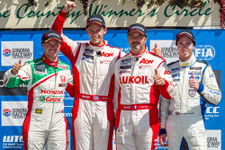 Race 1 podium: 1st place Tom Chilton, 2nd place Tiago Monteiro, 3rd place Yvan Muller with independent class winner Alex MacDowall
