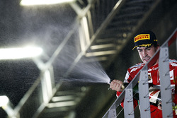 Fernando Alonso, Ferrari celebrates his second position with the champagne on the podium