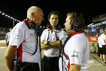 John Booth, Marussia F1 Team Team Principal with Marc Hynes, Marussia F1 Team Driver Coach and Dave Greenwood, Marussia F1 Team Race Engineer on the grid