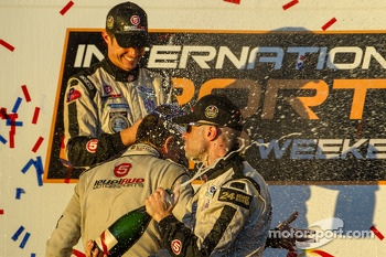 P2 podium: champagne for Marino Franchitti, Scott Tucker and Ryan Briscoe