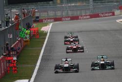 Sergio Perez, McLaren MP4-28 and Lewis Hamilton, Mercedes AMG F1