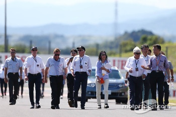 FIA delegates, including Gary Connely, FIA Steward and CAMS, Charlie Whiting, FIA Delegate and Herbie Blash, FIA Delegate, walk the circuit