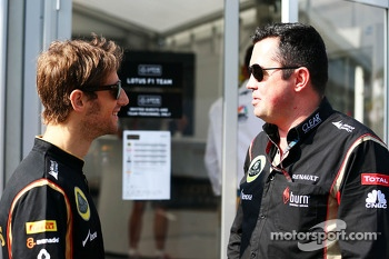 (L to R): Romain Grosjean, Lotus F1 Team with Eric Boullier, Lotus F1 Team Principal