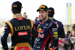 Race winner Sebastian Vettel, Red Bull Racing celebrates with Romain Grosjean, Lotus F1 Team on the podium