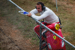 Olivier Beretta watches practice from the trackside