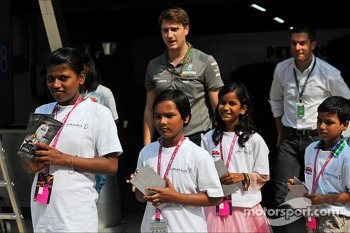 Local children with the Mercedes AMG F1 team