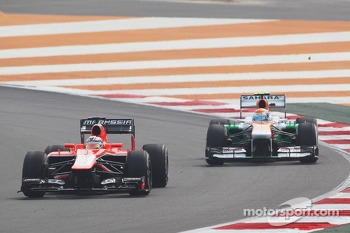 Jules Bianchi, Marussia F1 Team MR02 leads Adrian Sutil, Sahara Force India VJM06