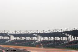 Sergio Perez, McLaren Mercedes and Sebastian Vettel, Red Bull Racing