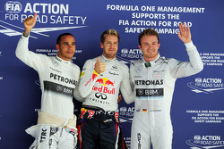 Qualifying top three in parc ferme: Nico Rosberg, Mercedes AMG F1, second; Sebastian Vettel, Red Bull Racing, pole position; Lewis Hamilton, Mercedes AMG F1, third