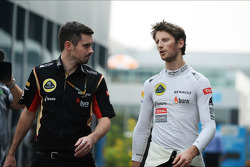 Romain Grosjean, Lotus F1 Team with Ben Cowley, Lotus F1 Team Press Officer