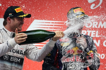 Podium: race winner and 2013 world champion Sebastian Vettel, second place Nico Rosberg