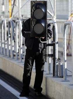 A worker installs the pitlane lights
