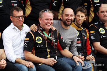 (L to R): Eric Lux, Genii Capital CEO; Gerard Lopez, Genii Capital; Romain Grosjean, Lotus F1 Team at a team photograph