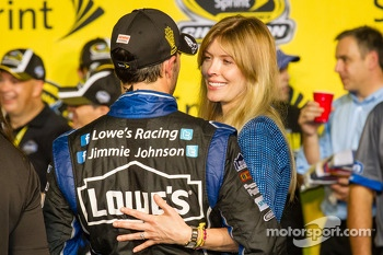 Championship victory lane: NASCAR Sprint Cup Series 2013 champion 2013 Jimmie Johnson, Hendrick Motorsports Chevrolet with wife Chandra