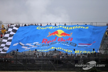 A large banner congratulates the Red Bull Racing team