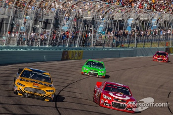 Marcos Ambrose, Richard Petty Motorsports Ford and Juan Pablo Montoya, Earnhardt Ganassi Racing Chevrolet