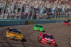 Marcos Ambrose, Richard Petty Motorsports Ford and Juan Pablo Montoya, Earnhardt Ganassi Racing Chevrolet