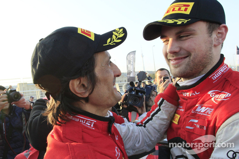 Stéphane Ortelli and Laurens Vanthoor celebrate the win and championship
