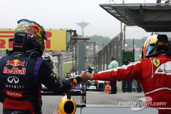 Race winner Sebastian Vettel, Red Bull Racing celebrates with Fernando Alonso, Ferrari in parc ferme