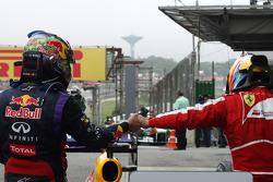 Race winner Sebastian Vettel, Red Bull Racing celebrates with Fernando Alonso, Ferrari in parc ferme