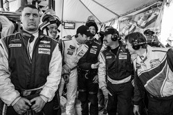 End of the race tension: Christian Fittipaldi watches the last minutes of the race with Action Express Racing team members