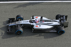Jenson Button, McLaren MP4-29 leaves the pits