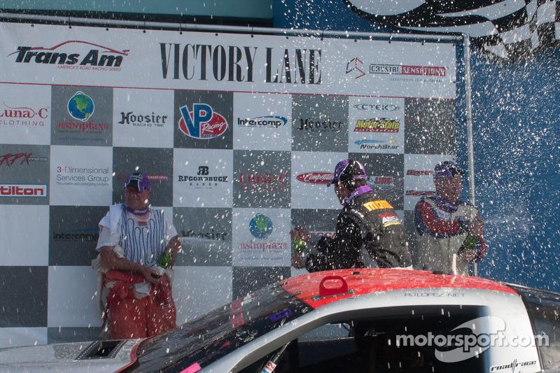 R.J. Lopez, Simon Gregg and Cliff Ebben celebrate on the podium