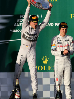 Nico Rosberg, Mercedes AMG F1 Team and Kevin Magnussen, McLaren F1