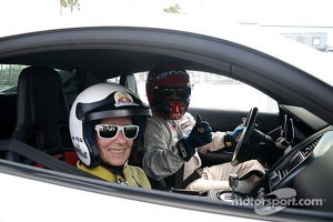 Motorsport.com writer Anne Proffit and Fabryce Kutyba in the GMG Audi R8