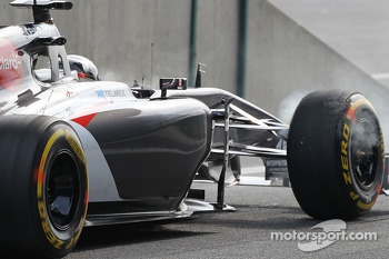 Adrian Sutil, Sauber C33 brakes smoking at the pit lane exit