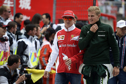 Kimi Raikkonen, Ferrari with Marcus Ericsson, Caterham on the drivers parade.