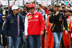 Felipe Massa, Williams with Fernando Alonso, Ferrari and Pastor Maldonado, Lotus F1 Team on the drivers parade.