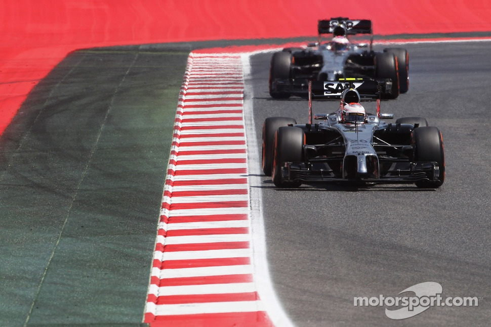 Kevin Magnussen, McLaren MP4-29 leads team mate Jenson Button, McLaren MP4-29