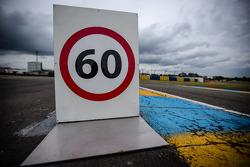 60-km/h limit sign at pit entrance