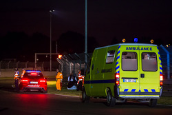 Medical staff arrive to  the scene of the #99 crash