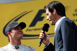 (L to R): Race winner Nico Rosberg, Mercedes AMG F1 with Mark Webber, Porsche Team WEC Driver on the podium