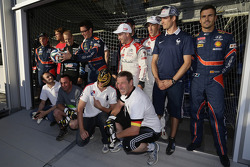 WRC drivers pose for photos after playing football