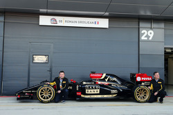 Paul Hembery Pirelli Motorsport Director and Mario Isola Pirelli Racing Manager and the Lotus F1 E22 with new 18 inch Pirelli tyres and rims