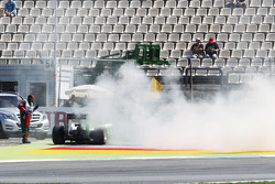 F1: Kamui Kobayashi, stops in the second practice session with a fire at the rear of the Caterham CT05