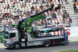 The Mercedes AMG F1 W05 of Lewis Hamilton, Mercedes AMG F1 is craned away after he crashed out of the first session of qualifying