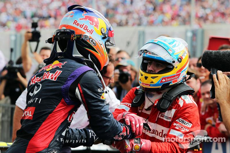 Daniel Ricciardo, Red Bull Racing celebrates with second placed Fernando Alonso, Ferrari in parc ferme