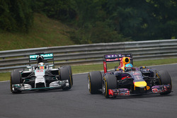 Sebastian Vettel, Red Bull Racing RB10 and Lewis Hamilton, Mercedes AMG F1 W05