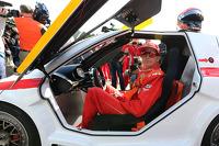 Kimi Raikkonen, Scuderia Ferrari drives a car from the Shell Eco Marathon