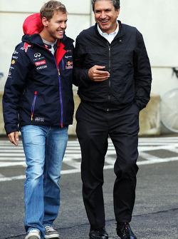 (L to R): Sebastian Vettel, Red Bull Racing with Pasquale Lattuneddu, of the FOM