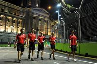 Max Chilton, Marussia F1 Team and Alexander Rossi, Marussia F1 Team Reserve Driver, walk the circuit