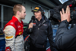 Race winner and Blancpain Endurance Series champion Laurens Vanthoor with John Watson